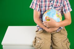 Globe of the world. Cropped image of schoolboy with a globe of the world Royalty Free Stock Photo