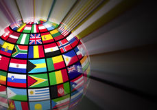 Globe with world flags. Global communication concept: glowing globe with world flags isolated on black background Stock Image