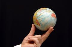 Globe XVII. Man holding world globe with his fingertips Stock Photo