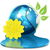 Globe and yellow flower Royalty Free Stock Photos