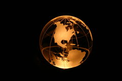 Globe in yellow light. Planet earth as crystal ball in yellow light Royalty Free Stock Photo