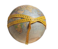 Globe with yellow measure tape Stock Image
