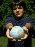 Globe for you. Boy and globe ,focus on globe royalty free stock image