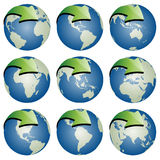 Globes with arrows Stock Photos