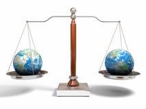 Globes on balance scale