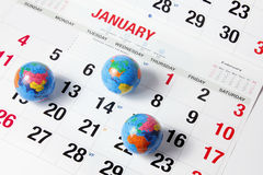 Globes on Calendar Pages Royalty Free Stock Photography
