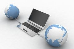 Globes connecting via usb to laptop Royalty Free Stock Photography