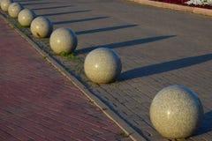Globes de granit allumés par le coucher de soleil Photographie stock libre de droits
