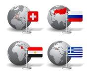 Globes de Gray Earth avec la désignation de la Suisse, Russie, Egypte Photographie stock libre de droits