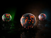 Globes in fire. Of different colors Royalty Free Stock Image