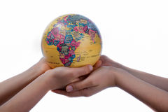 Globes in hand. Two hands holding holding a globe in hand on white background Stock Image