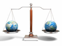 Globes On Balance Scale Royalty Free Stock Photography
