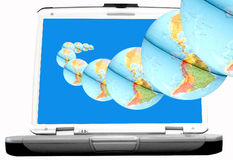 Globes out of laptop Royalty Free Stock Image