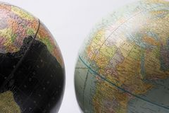 Globes showing Africa. Surface of two globes showing map of African continent, studio background Royalty Free Stock Photography