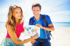 Globetrotters. Couple of globetrotters holding a map Stock Photo