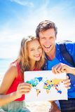 Globetrotters. Couple of globetrotters holding a map Royalty Free Stock Photography