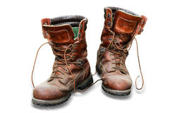 Globetrotters. Solid hiking shoes isolated on white background Stock Images
