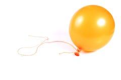 Globo amarillo con la cuerda de rosca Imagen de archivo
