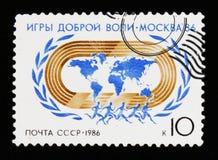 Globo, atleti, emblema dei giochi di benevolenza a Mosca, circa 1986 Fotografia Stock Libera da Diritti