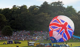 Globo caliente del GB de las personas del festival 2012 del globo de Bristol Foto de archivo libre de regalías