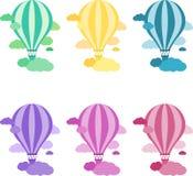 Globo colorido del aire caliente en el cielo Imagen de archivo libre de regalías