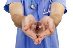 Globo da mão do doutor fotografia de stock
