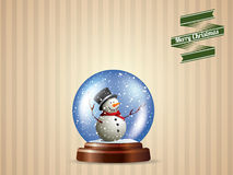 Globo da neve com cartão do boneco de neve Fotografia de Stock