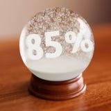 Globo da neve com título de um disconto de 85 por cento para dentro Fotos de Stock Royalty Free
