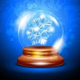 Globo da neve do Natal com um floco de neve Foto de Stock
