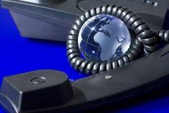 Globo de cristal con el teléfono Fotografía de archivo