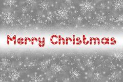 Globo de la Navidad en fondo gris con nieve Imagen de archivo