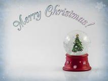 Globo de la nieve de la Feliz Navidad imagen de archivo libre de regalías