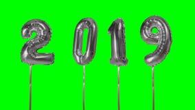 Globo de la plata de la celebración del aniversario del cumpleaños de la Feliz Año Nuevo del número 2019 que flota en fondo de pa metrajes