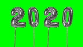 Globo de la plata de la celebración del aniversario del cumpleaños de la transición de la Feliz Año Nuevo del número 2020 a parti almacen de metraje de vídeo