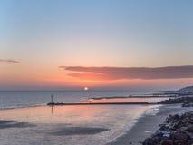 Globo de la salida del sol con marea baja Imagen de archivo
