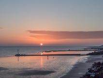 Globo de la salida del sol con marea baja Imagen de archivo libre de regalías