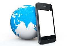 Globo de la tierra con el teléfono móvil Imágenes de archivo libres de regalías