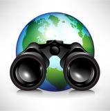 Globo de la tierra con los prismáticos Imágenes de archivo libres de regalías