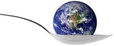 Globo de la tierra en una cuchara Foto de archivo libre de regalías