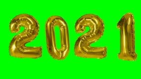 Globo de oro de la celebración del aniversario del cumpleaños de la Feliz Año Nuevo del número 2021 que flota en fondo de pantall metrajes