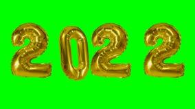 Globo de oro de la celebración del aniversario del cumpleaños de la Feliz Año Nuevo del número 2022 que flota en fondo de pantall metrajes