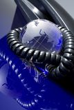 Globo de vidro com telefone Imagens de Stock Royalty Free