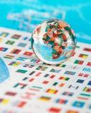 Globo de vidro nas bandeiras Imagens de Stock