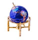 Globo de vidro no suporte brilhante amarelo do metal Imagem de Stock Royalty Free