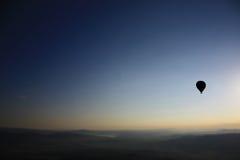 Globo del aire caliente de la silueta Imagen de archivo