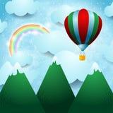 Globo del aire caliente sobre la montaña Fotografía de archivo libre de regalías