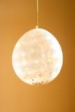 Globo del confeti en tonos de oro Fotos de archivo libres de regalías