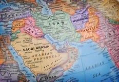 Globo del mondo che mette a fuoco sull'Iraq fotografie stock