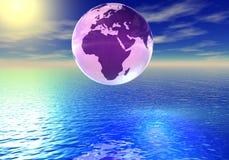 Globo del mundo sobre el océano Foto de archivo libre de regalías