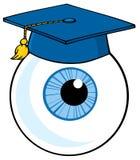 Globo del ojo azul que desgasta un casquillo de la graduación Fotos de archivo